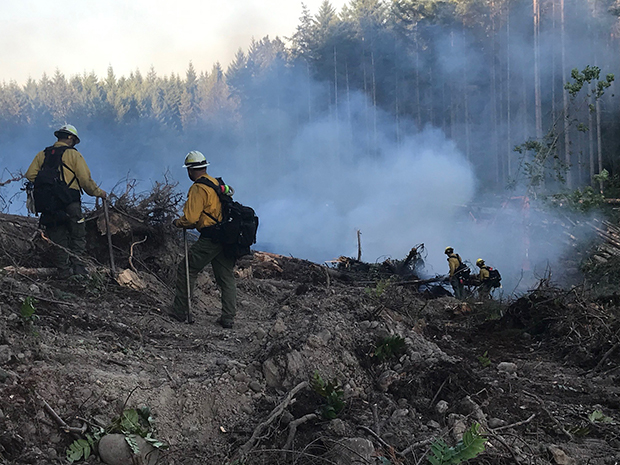 Vail team fighting a fire